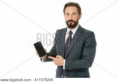 Smartphone Concept. Bearded Man Point Finger At Smartphone. Business Man Hold Smartphone. Smartphone