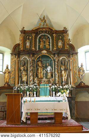 SVETI PETAR MREZNICKI, CROATIA - JULY 14, 2013: High altar in the parish church of St. Peter in Sveti Petar Mreznicki, Croatia