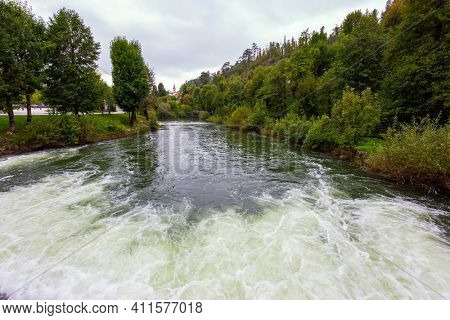 Picturesque river in the huge green park. Postojna Cave. The famous and most visited place in the country by tourists. Travel to Eastern Europe. Magical places in Slovenia