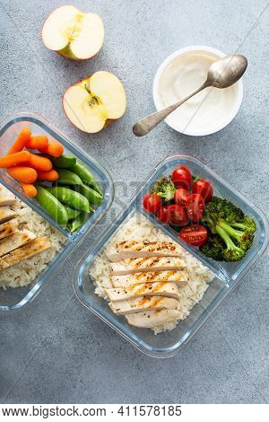 Meal Prep Containers With Healthy Lunch To Go For Work Or School With Grilled Chicken, Rice And Vege