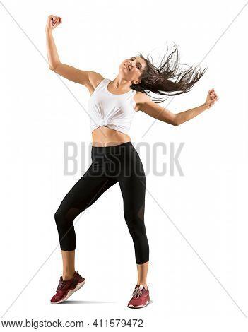 Sporty woman with black hair jumping on white background