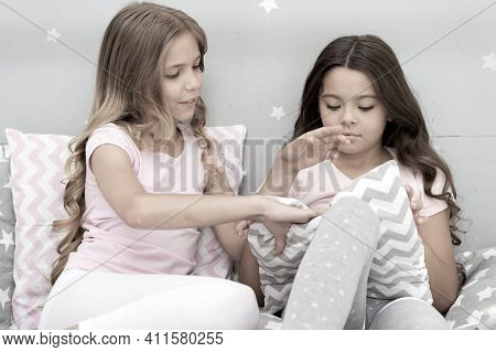 Evening Time For Fun. Girls Happy Best Friends Or Siblings In Cute Stylish Pajamas With Pillows Slee