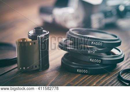 Old Photo Film Cassette, Photo Filters, Vintage Camera On Background, Selective Focus.