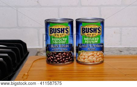 Two Cans Of Bushs Reduced Sodium Beans, Black And Great Northern For Illustrative Editorial