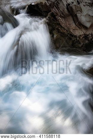 Torrent Of Crystalline Water In A Mountain River, On A Bedrock, Long Exposure With Silk Effect, Cata