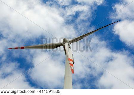 Wind Turbine with cloudy sky background