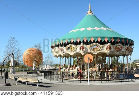 IRVINE, CA - FEBRUARY 10, 2015: The Orange County Great Park Carousel Ride. The carousel ride is one of two current attractions at the Great Park, the other being the balloon, in the background.