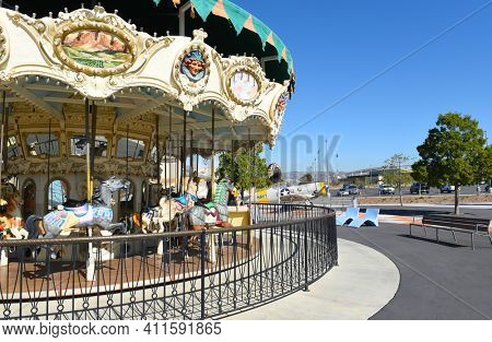 IRVINE, CA - JANUARY 31, 2018: Great Park Carousel closeup. Vintage airplane, Hangar and Soccer Stadium are in the background.