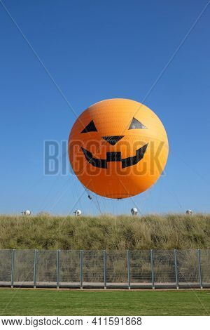 IRVINE, CA - OCTOBER 14, 2016: The Orange County Great Park Balloon Ride. The balloon, decorated for Halloween ride, is one of two current attractions at the Great Park, the other being the carousel.