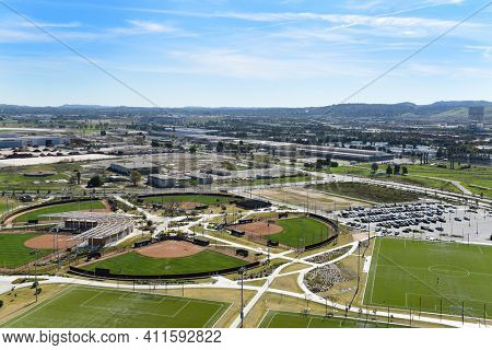 IRVINE, CALIFORNIA - 31 JAN 2020: Aerial view of sports fields at the Orange County Great Park, with south county in the distance.