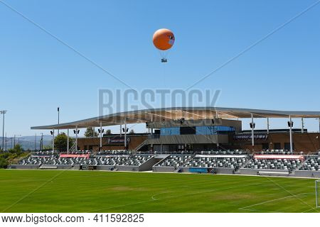 IRVINE, CALIFORNIA - 30 AUG 2020: The Orange County Great Park Balloon and soccer stadium sporting a COVID-19 face mask and sunglasses to remind visitors of the need to social distance and cover up.