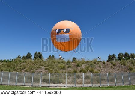 IRVINE, CALIFORNIA - 30 AUG 2020: The Orange County Great Park Balloon ride sports a COVID-19 face mask and sunglasses to remind visitors of the need to social distance and cover up.