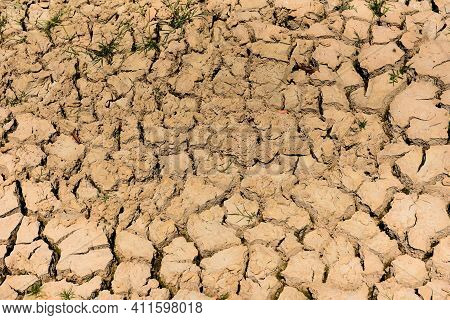 Cracked Soil Arid Land With Dry And Cracked Ground Desert Texture Background, Global Warming Concept