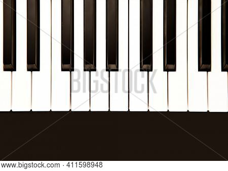 Illustration of piano keyboard and black stripe with copy space. music writing background concept digitally generated image.