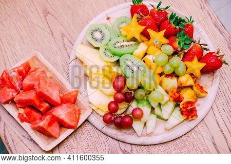 Raw Organic Fruit Platter With Berries, Melons, Kiwi, Mango, Pineapple, Carambola, Watermelon, Prick
