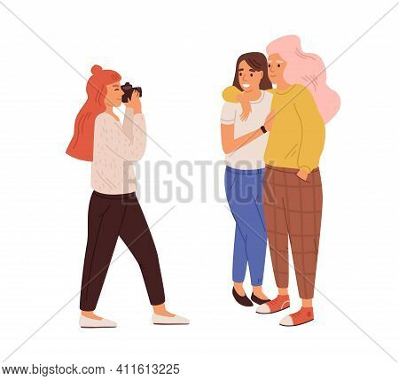 Photographer Taking Photo Of Lesbian Love Couple. Young Woman With Camera Shooting Portrait Of Smili