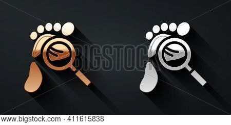 Gold And Silver Magnifying Glass With Footsteps Icon Isolated On Black Background. Detective Is Inve