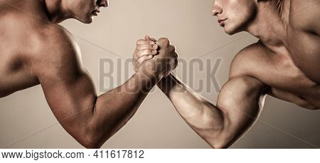 Two Hands. Muscular Men Measuring Forces, Arms. Hand Wrestling, Compete. Hands Or Arms Of Man. Muscu