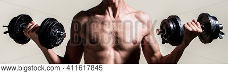 Man Holding Dumbbell In Hand. Skinny Guy Hold Dumbbells Up In Hands. A Thin Man In Sports With Dumbb