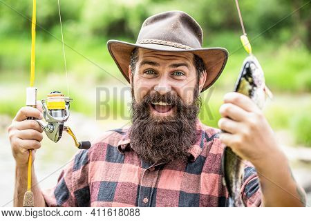 Man Hold Big Fish Trout In His Hands. Fisherman And Trophy Trout. Man Holding A Trout Fish. Fishing.