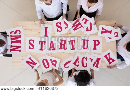 Multi-ethnic Group Of Diverse People Putting Letters Startup Start Up Start-up Teamwork Cooperation