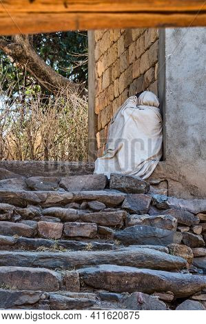 Yeha, Ethiopia - Feb 10, 2020: An Orthodox Pilgrim At The Great Temple Of The Moon, Privy To Walia I