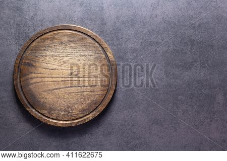 Meat or bread cutting board for homemade baking on table. Food recipe concept at stone background texture with copy space. Flat lay top view