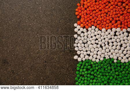 Kalu Or Tiny Balls Of Sugar Syrup With Sesame Seeds Inside For Sankranti Festival In Maharashtra