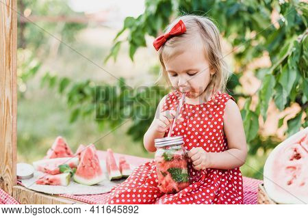 Lemonade Stand. Adorable Little Girl Trying To Sell Lemonade. Watermelon Lemonade With Ice And Mint