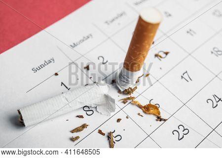 Calendar Sheet With Broken Cigarette, Closeup. Quitting Smoking Concept