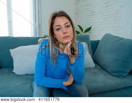 Bored Woman Watching Tv Helpless In Self Isolation At Home During Mandatory Lockdown Due To Coronavi