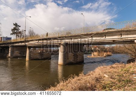 A Concrete Bridge Over The Bóbr River In The Center Of The City Of Zagan In Western Poland. The Brid