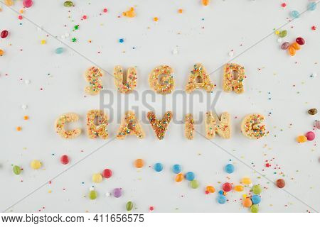 Sugar Craving Inscription Made Of Biscuit Letters And Decorated With Rainbow Sprinkles