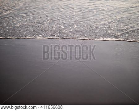 Wave Close Up On Black Sand Beach. Waterscape Background. Selected Art Focus. Black Sand Beach With