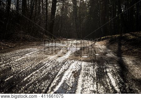 Wheel Off-road Track In A Countryside Landscape With A Muddy Road / Extreme Path Rural Dirt Road In