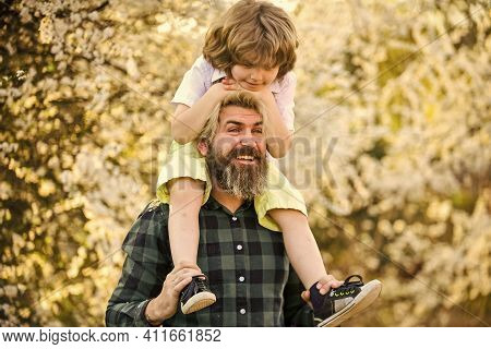 Happy Family. Fatherhood Happiness. Fathers Day. Earth Day. Little Boy And Father In Nature Backgrou