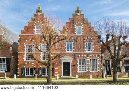 Front Facade With Step Gables On Historic Houses In Sloten, Netherlands