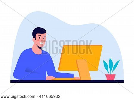 Smiling Man Working At Computer At Office Or At Home. Computer On The Table - Monitor And Keyboard A