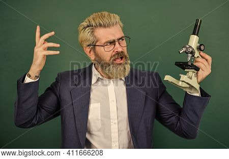 Scientific Research. Fascinating Research. Teacher With Microscope. Man Hipster Classroom Chalkboard