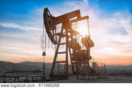 Oil Drilling Derricks At Moutain Oilfield For Fossil Fuels Output And Crude Oil Production From The