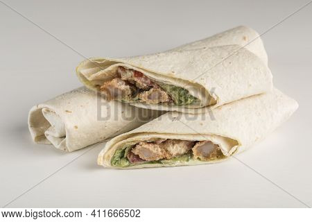 Pita Bread Roll With Breaded King Shrimp And Fresh Salad On A White Background, Isolated. Close-up W