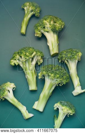 Top View Of Slice Of Brocoli On Green Background