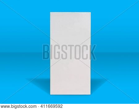 White Folding Cartons Isolated On Blue Color Background. Paperboard Boxes Front View. Straight Tuck