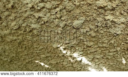 Static Cement Background With The Use Of Crumbs Of Sand As Part Of The Composition, Visible Obliquel
