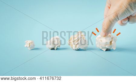Human's Hand Choose The Best Crumple Paper  With Blue Background, Best Choice, Good Idea , Select Th