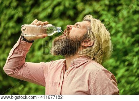 Summer Heat. Drinking Clear Water. Water Balance. Man Bearded Tourist Drinking Water Plastic Bottle