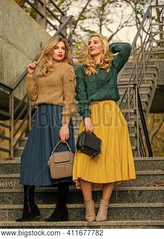 Charm. Stylish Autumn Women Outdoor. Girl Friends Go Upstairs. Fall Season Color Trends. Pleated Tre