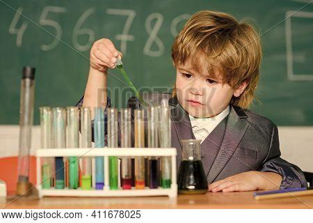 Boy Test Tubes Liquids Chemistry. Chemical Analysis. Knowledge Day. Kid Study Chemistry. Biotechnolo
