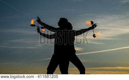 Ignite Your Dancing Flame. Dancing Couple Spin Burning Poi. Flame Dancers On Idyllic Sky. Evening Sh