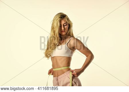 Confident In Fitness Regime. Woman Measuring Tape. Fit Girl Has Sporty Body. Sport And Fitness. Slim
